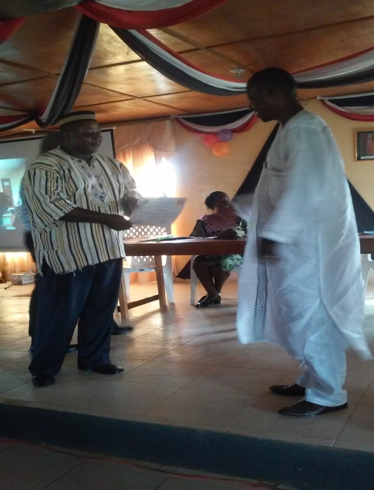 Former Superintendent Gbowee recieves honor from Superintendent Sarnor of Gbarpolu County